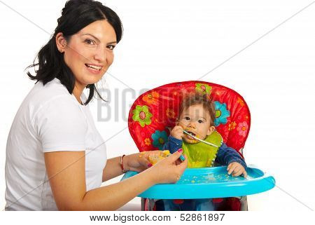 Mother Feed Her Baby Boy