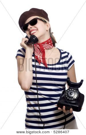 beautiful girl with red bandana beret and striped shirt in a classic 60s french look is holding an old rotary phone poster