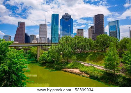 Houston Texas Skyline with modern skyscrapers and blue sky view from park river US