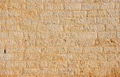 Texture ofgolden wall built of yellow stone blocks poster