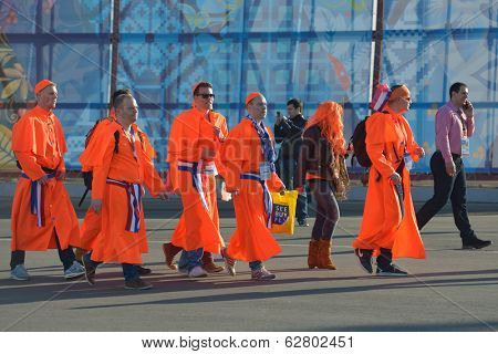 SOCHI, RUSSIA - FEBRUARY 12, 2014: Dutch fans in the colors of team Netherlands go to the competitions in the park. Dutch Speedskaters dominate at XXII Winter