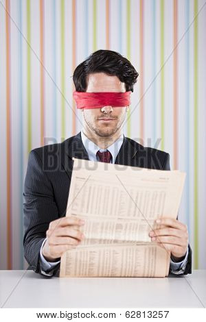 Blind reading a newspaper poster