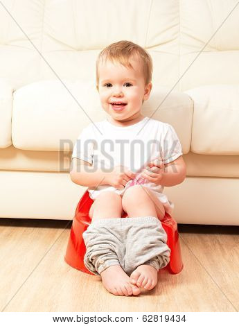 Baby Sitting On Potty In Toilet