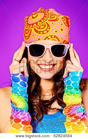 Close-up portrait of a cheerful teenager girl in bright casual clothes smiling at the camera with beautiful smile.