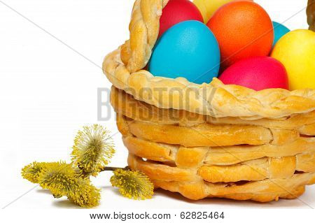 Baked Basket With Easter Colored Eggs And Bunch Of Willow