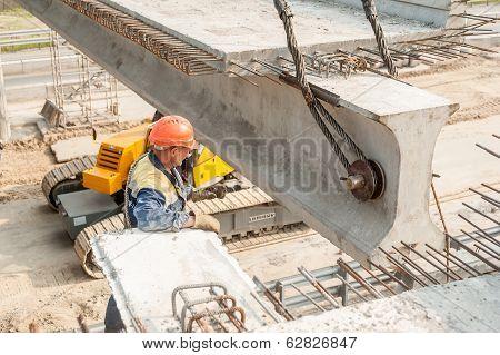 Workers mount bridge span