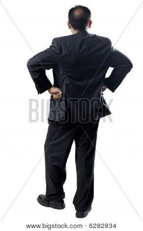 Bald Man In Suit Arms Akimbo