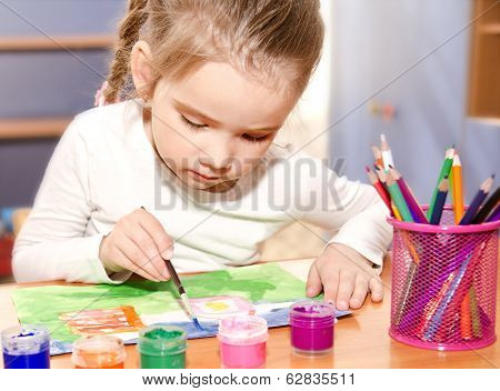 Little Girl Drawing With Paint And Paintbrush