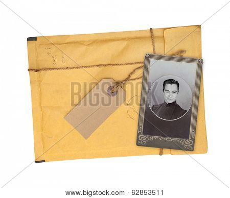 Old envelope and photo. Isolated on white background