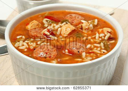 Bowl of Cajun Spicy Chicken and Sausage Gumbo Soup at Table
