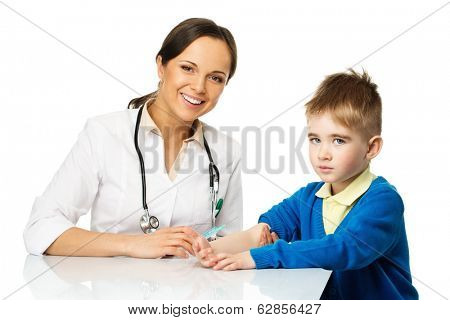 Little boy at paediatrician doing vaccination