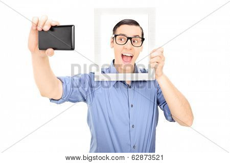 Man taking a selfie and holding a picture frame isolated on white background