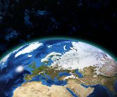 Planet Earth with sun rising over European countries (Elements of this image furnished by NASA) poster