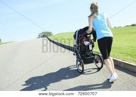 Mother training baby cart back view