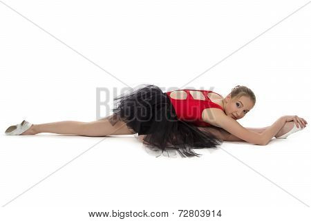 Photo of young stretching ballet-girl