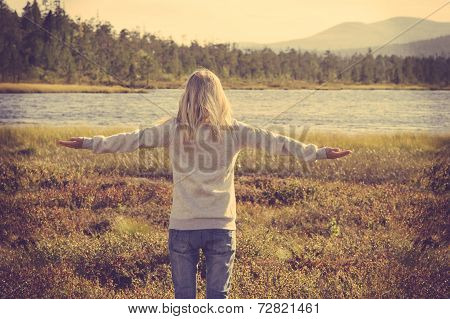 Young Woman relaxing outdoor hand raised Lifestyle vacations concept