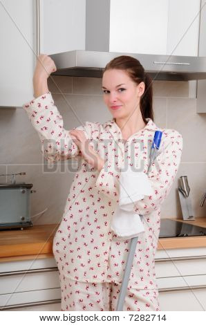 Strong Woman In Pyjamas Cleaning The Kitchen