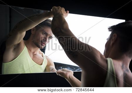 Narcissistic Young Man Admiring His Reflection