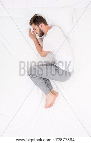 Male sleeping Foetus pose
