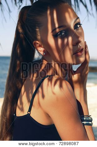 Portrait Of Pretty Young Woman With Long Hair Posing On Beach