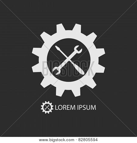White Gear Wheel And Tools As Logo On Dark Grey Background