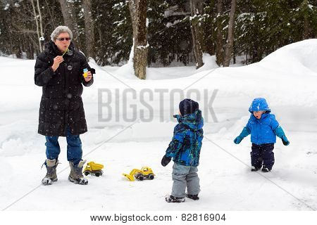 Family Playing Outside In The Winter