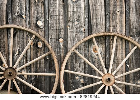 Close Up Of Two Vintage Wagon Wheels