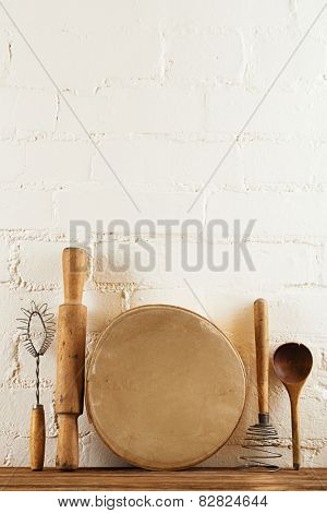mashers retro kitchen utensils  on old wooden table in rustic style