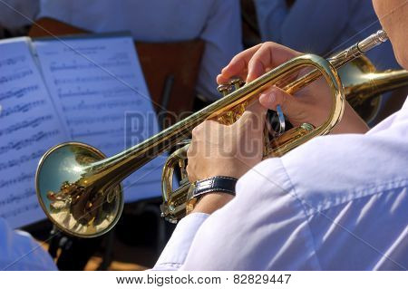 Musician playing on trumpet