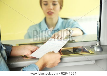 Teller window with working cashier. Concept of payment of utilities
