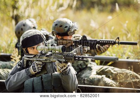 Soldiers Shoot At A Target From The Weapon