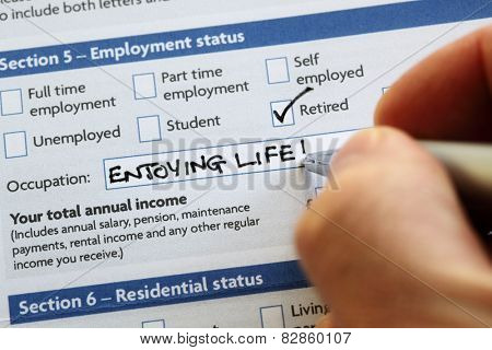 Writing retired and enjoying life on an application form concept for a comfortable retirement