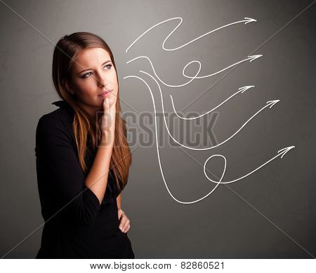 Attractive young teenager looking at multiple curly arrows