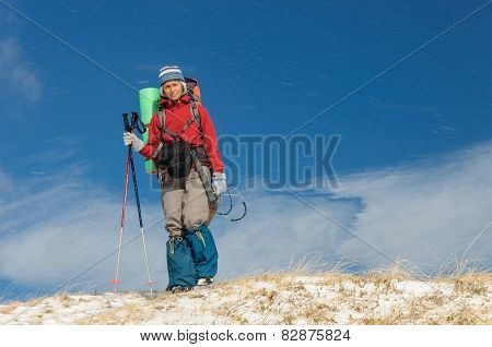 Young woman doing ski touring in winter mountains