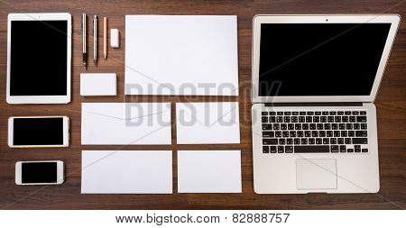 Blank Template. Consist of Laptop,Business cards, letterhead a4, Tablet PC, eraser ,pen,pencil,envelopes and smart phones.