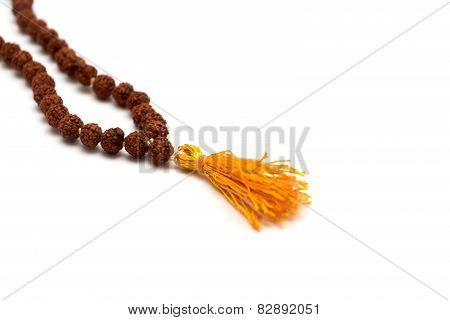 Japa mala. Prayer beads made from the seeds of the rudraksha tree. Isolated on white background poster