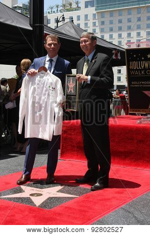 LOS ANGELES - JUN 2:  Bobby Flay presenting Leron Gubler with MESA Grill chef jacket for future WOF museum at the Bobby Flay Hollywood WOF Ceremony on Hollywood Blvd on June 2, 2015 in Los Angeles, CA