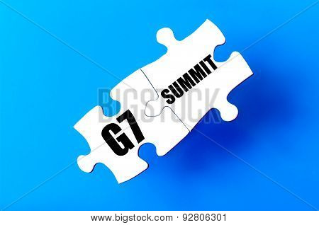 Connected puzzle pieces with words G7 and SUMMIT against blue background. Concept image with copy space available. poster