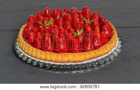 Strawberry Cake With Mint Leaves On A Anthracite Wood