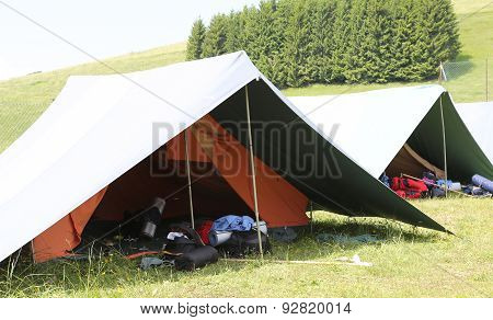 Big Tent Of Boy Scout Camp With Backpacks