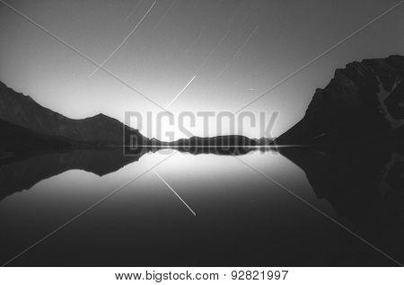 shooting stars over the mountain lake