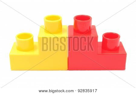 Red And Yellow Building Blocks On White Background