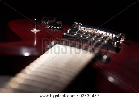 Electric Guitar Close Up On Dark Background