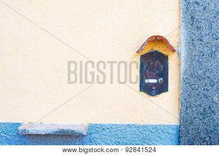 Old Fashioned Doorbell On Orange Wall