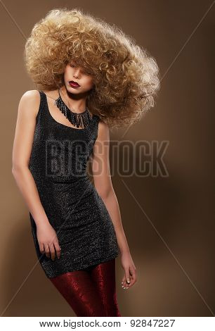 Vogue Style. Stylish Woman With Extravagant Hairstyle