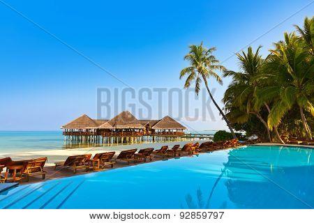 Pool on tropical Maldives island - nature travel background