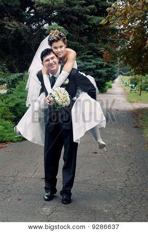 bride piggyback on groom