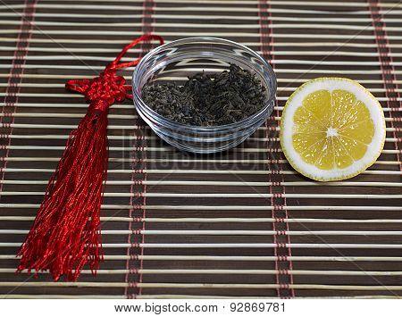 Saucer With Tea And A Row A Lemon, On A Rug