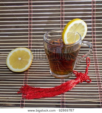 Glass Of Tea And Nearby Lemon, On A Rug