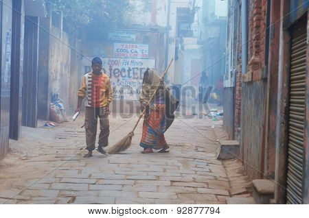 Indian Woman Sweeps Street Cold Foggy Winter Morning In Varanasi
